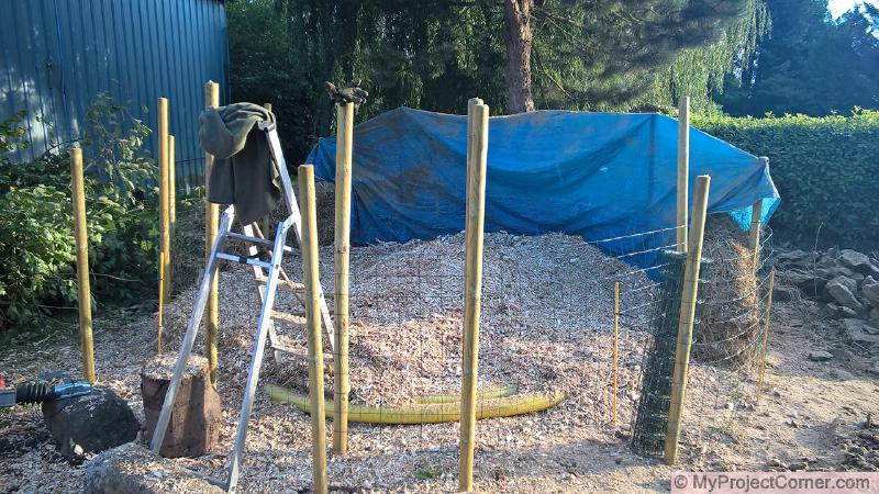 base layer of wood chips for compost pile