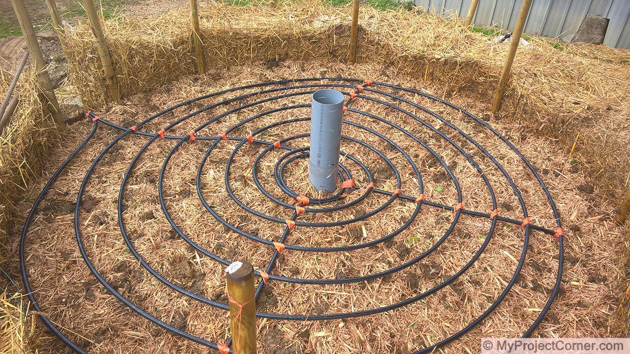 Construyendo las capas para el sistema de calentamiento del compost
