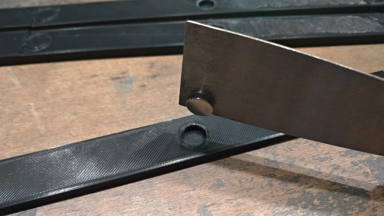 insérer les aimants à l'aide d'une spatule