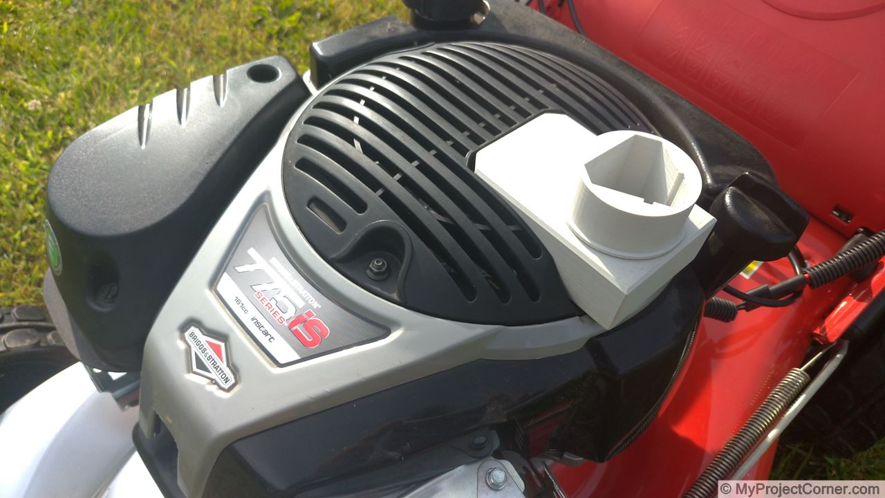 The Briggs & Stratton Lidl battery adaptor on the lawnmower