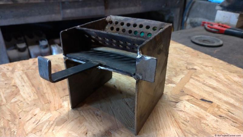 pellet rocket stove combustion chamber three