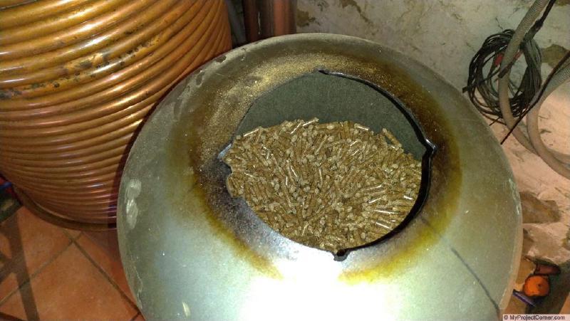 wood pellets in rocket stove hopper