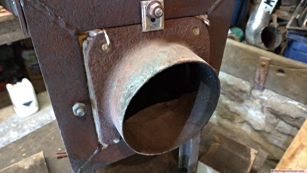 pellet rocket stove fire box flue mounting
