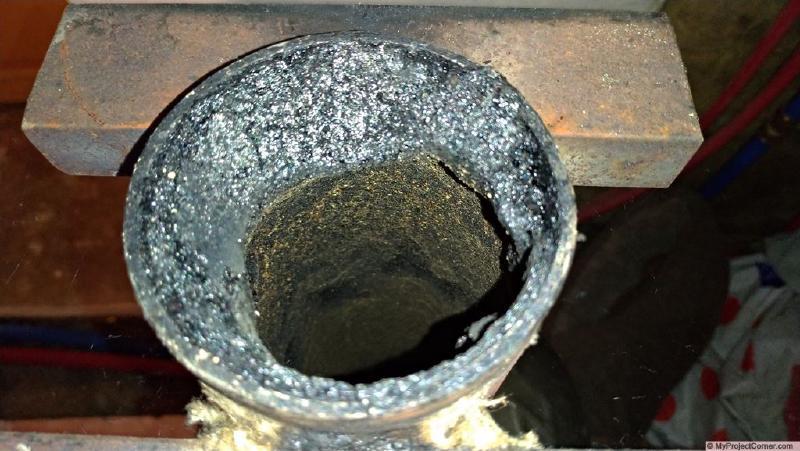 tar build up in pellet feed pipe