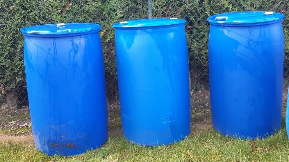 plastic barrels for my greenhouse planter