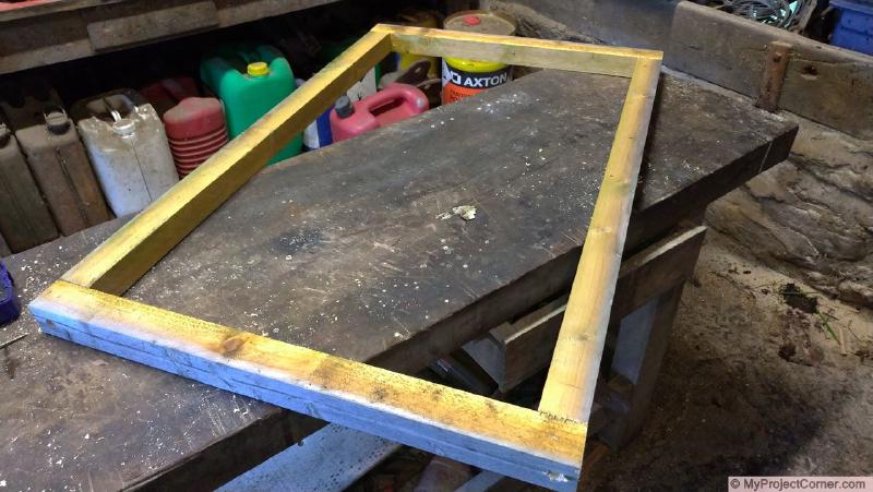 Wooden frame for recycled barrel planter