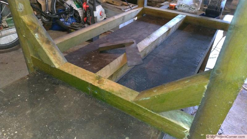 Wooden framework for recycled barrel planter with bracing