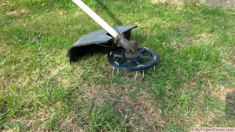 3D printed scarifier mounted on strimmer